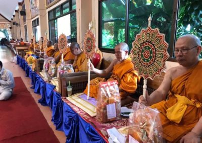 We make merit and were listening to Buddha's teaching at Wat Sriboonruang in occasion of birthday of King Rama 10
